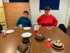Two ladies enjoying some Cake, Coffee and Chat. Sitting at a table in Triple Tap Tech office.