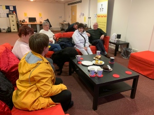 One of our groups enjoying some cakes. Sitting around the coffee table.