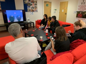 The Accessible Games Club enjoying audio games in our office.
