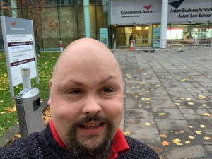 Frasee standing in front of the aston conference centre.