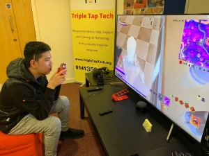 A young boy playing fortnight with visual enhancement.